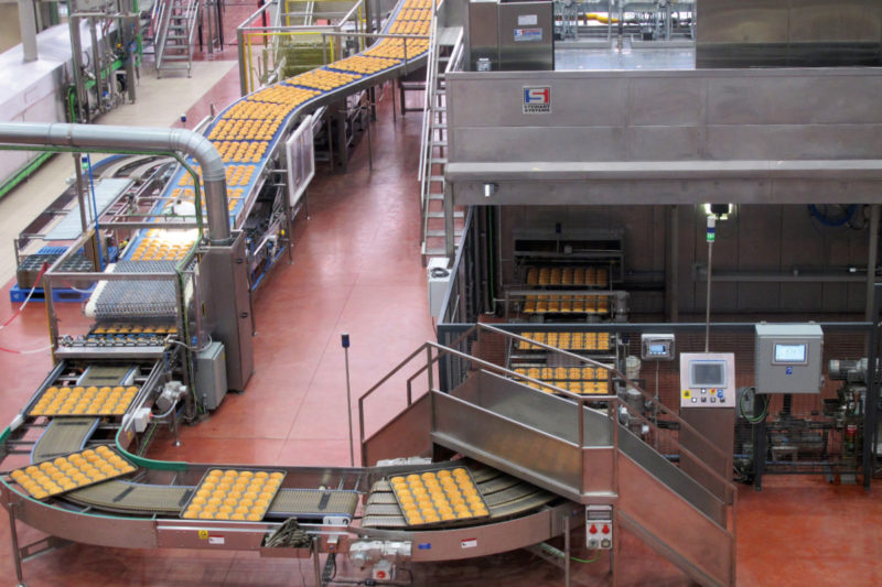 The bakery's conveyorized oven cranks out tens of thousands of uniform buns an hour for food service and retail customers.