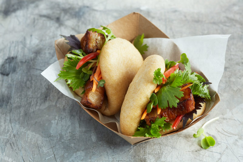 Bao buns to banh mi, Asian street eats continue to roll onto U.S. menus. Indian flatbreads using durum wheat atta flour, such as unleavened roti and leavened naan, may be paired with various meats and vegetables in wrap, panini, pita or open-faced formats. Trending sandwich toppings include Korean kimchi; swap it in for sauerkraut to reimagine the classic Reuben.