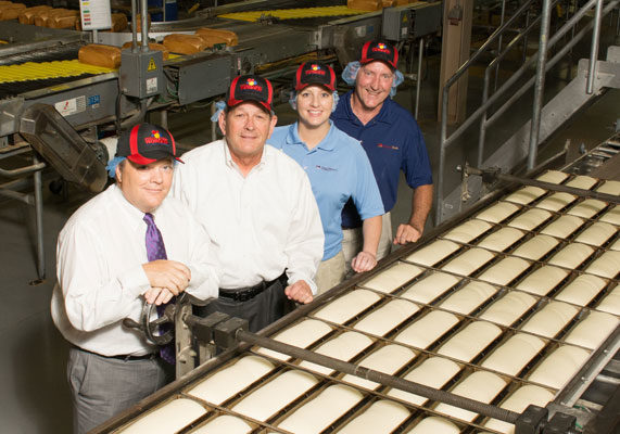 Flowers Foods returned Wonder Bread production to the Midwest and started baking its popular Nature's Own, Cobblestone Bread Co. and Sunbeam brands at the newly renovated Lenexa, KS, bakery. The project involved (from left) Robert Benton, senior vice-president and chief manufacturing officer; Ken Buxton, vice-president of project management; Amber Mangiaracino, director of manufacturing at Lenexa; and Tim Gentry, vice-president, compliance and field service.