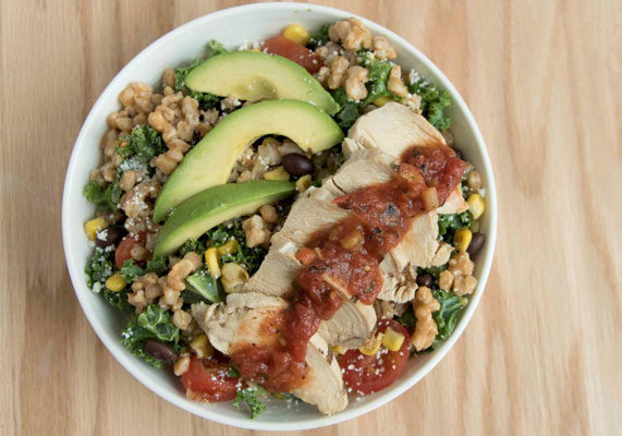 """Bowls, which may feature grains in salad or grains in soup, are eaten throughout the day. """"Millennials just love their bowls,"""" Ms. Nielsen said. Thrive360 Eatery in Chicago features a salad bowl with farro, avocado and chicken. For a similar trend, cereal cups and grain cups are showing up in hotels and restaurants. (1 of 6)"""