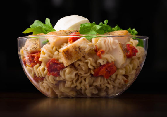 The Mozza Salad from France features a balsamic dressed pasta salad with roasted tomatoes,mozzarella cheese, arugula leaves and a choice of crispy or grilled chicken all served with a breadstick. (1 of 6)