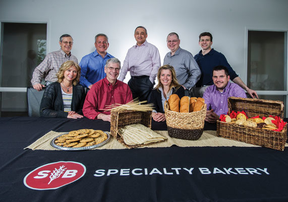 Specialty Bakery's leadership team includes (front row, from left) Laura Reeves, human resources director; Jim Zakian, executive vice-president of supply chain; Cristy Sinclair, director of food safety and quality, and Duane Brunner, controller, and (back row, from left) Terry Luther, vice-president of procurement; David D'Onofrio, senior vice-president, sales and marketing; Ahmad Hamade, CEO; Jim Little, vice-president of innovation and quality, and Keith Petrofsky, director of innovation.