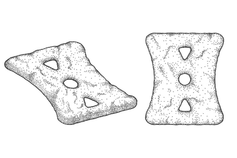 This patent displays a flat snack food with three cutouts in its center.