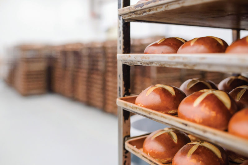 Soft pretzel buns, twists and bites cool in ambient temperature before being bagged or packaged in tubs.