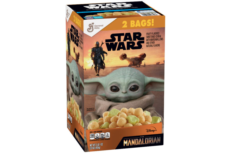 """General Mills, Inc. has developed a new ready-to-eat cereal based on Disney's Star Wars show, """"The Mandalorian."""" The Mandalorian Cereal features fruit-flavored sweetened corn puffs with green marshmallows shaped like the Child from the show. Each 1-cup serving contains 150 calories and 12 grams of sugar. The cereal will be available at all Sam's Club locations in late July and in Walmart stores beginning in mid-August."""