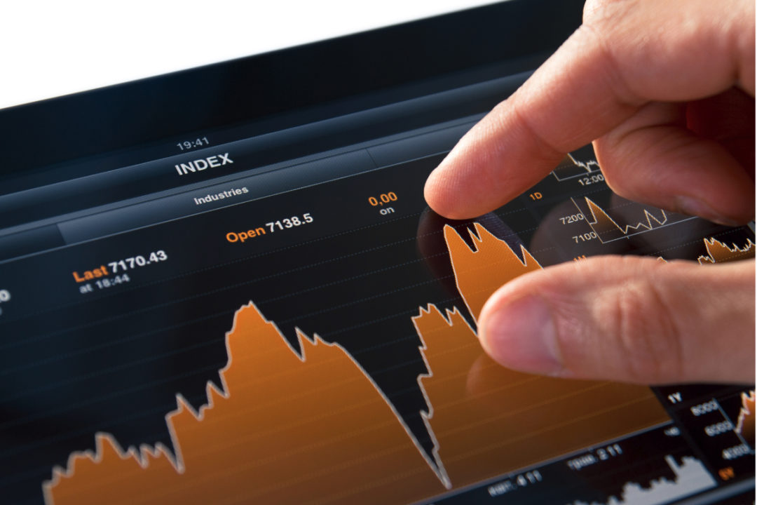 Checking stock market on tablet