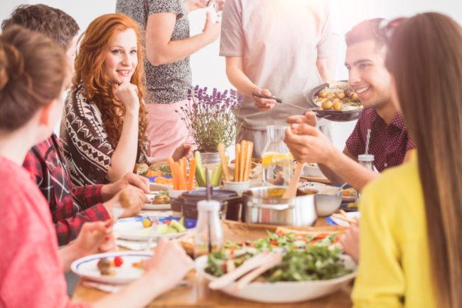 Millennials eating dinner