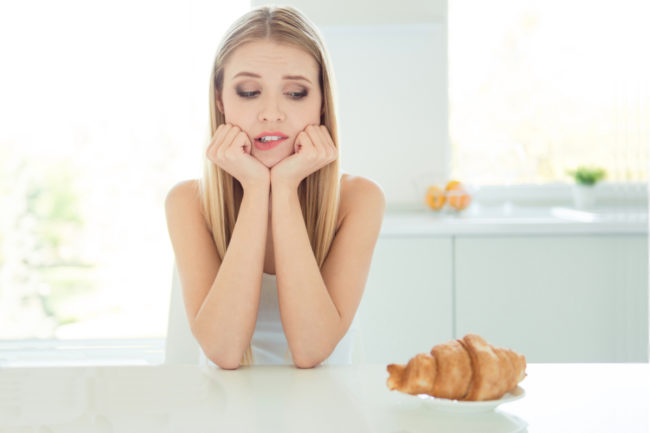 Woman worrying about eating carbs