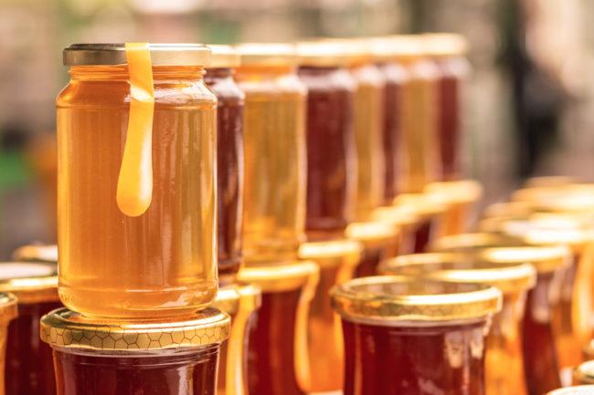 Jars of colorful honey
