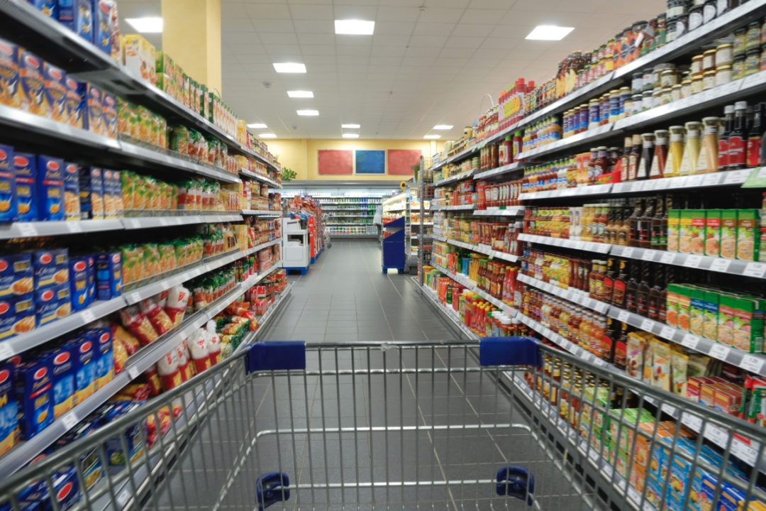 Packaged foods in grocery store aisle