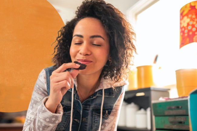 Young woman snacking on Oreos