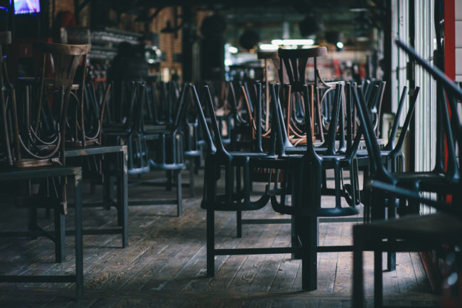 Closed and empty restaurant with chairs and tables stacked