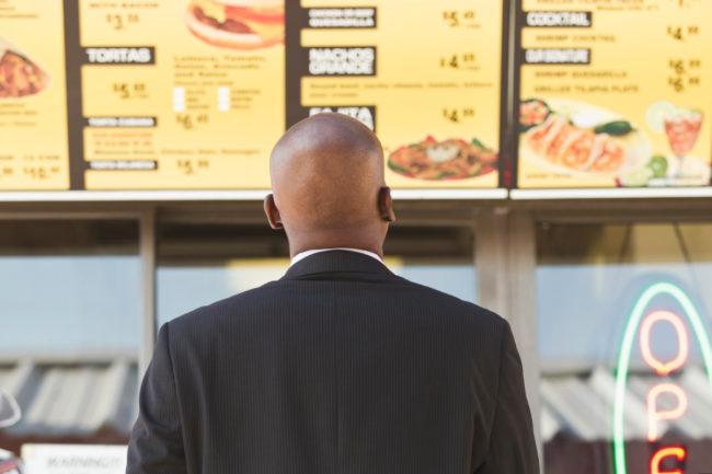 Man reading calories on menu