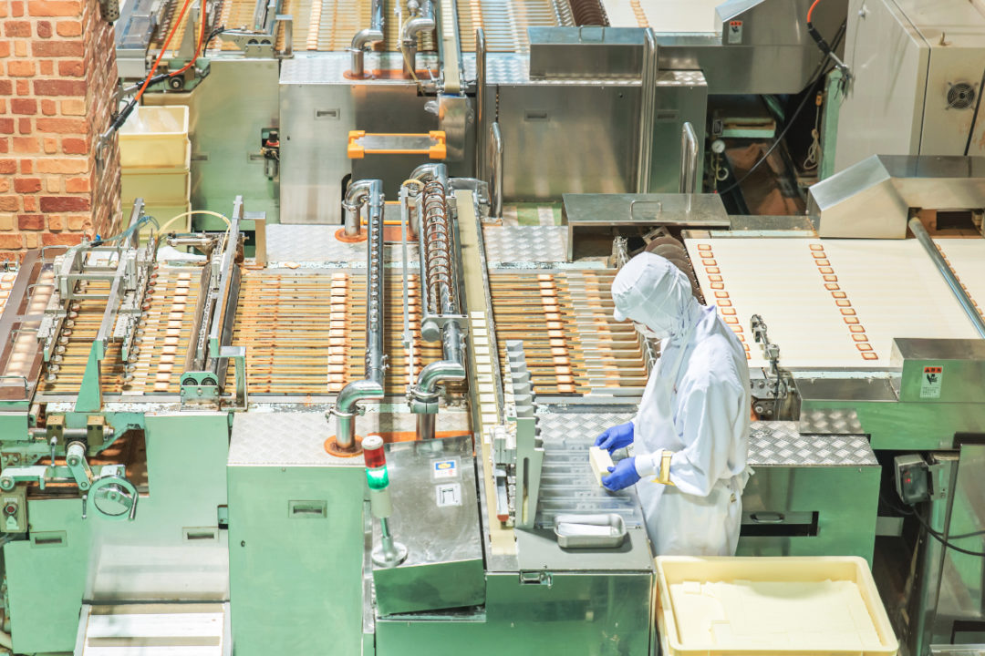 Solo worker in food processing facility