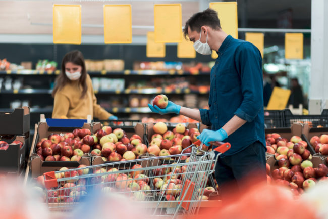 Grocery shopping wearing masks during COVID-19 pandemic