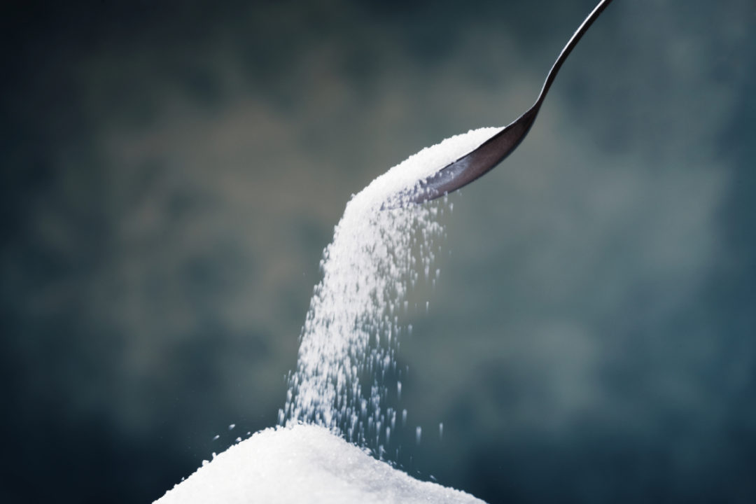 Spoon pouring out sugar