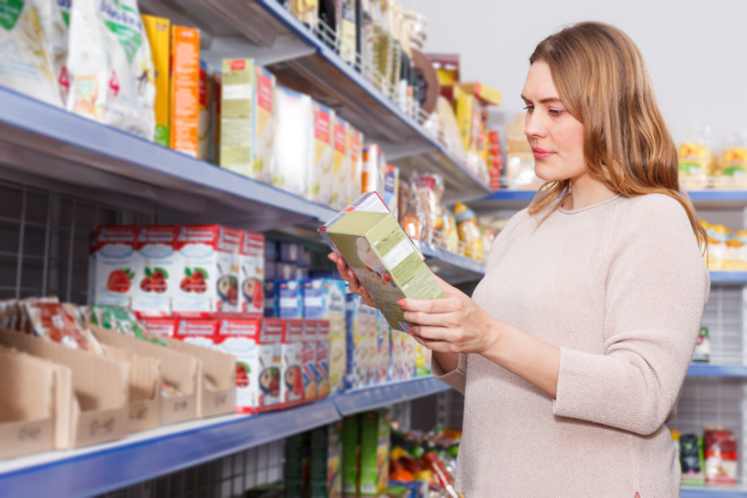 grocery shopper reading label on cereal box