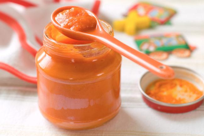 Jar of orange baby food