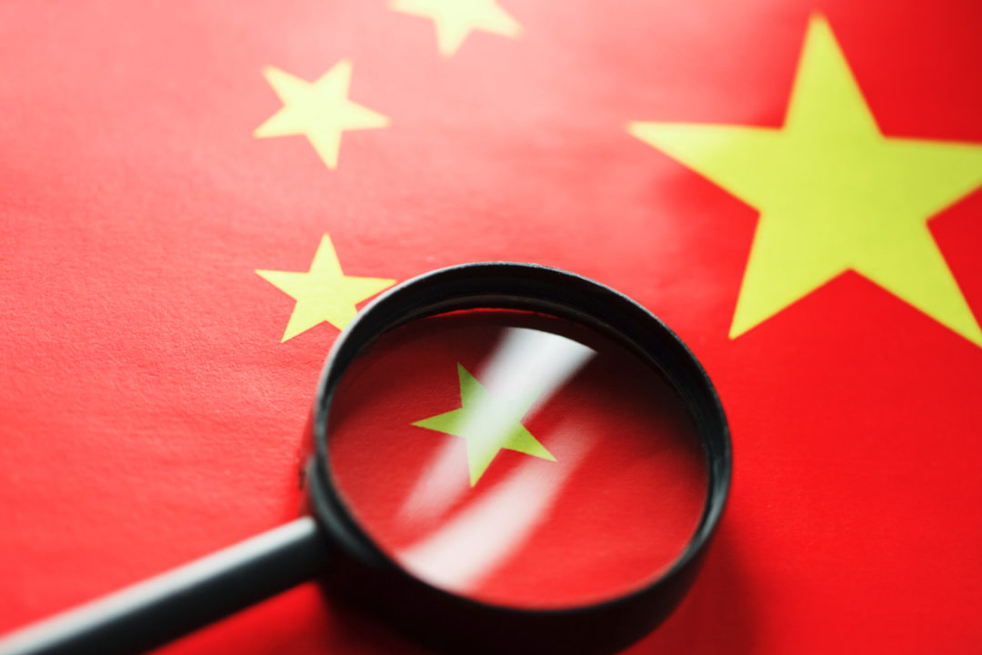 China flag and magnifying glass