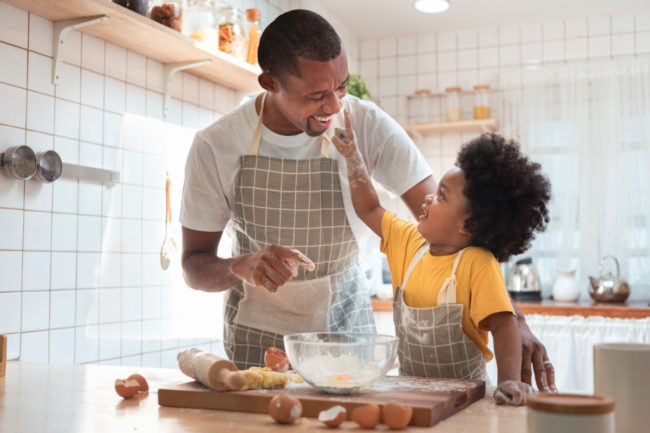 Father and son baking at home