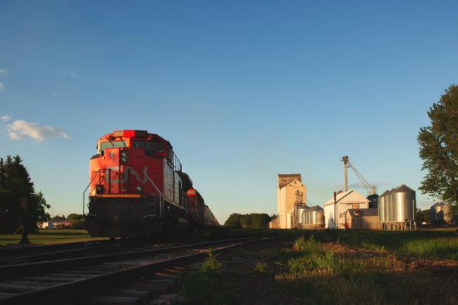 Train leaving grain elevator