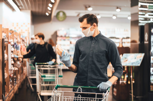 Man shopping for bread during pandemic