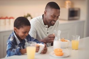 Fathersoneatingcereal lead