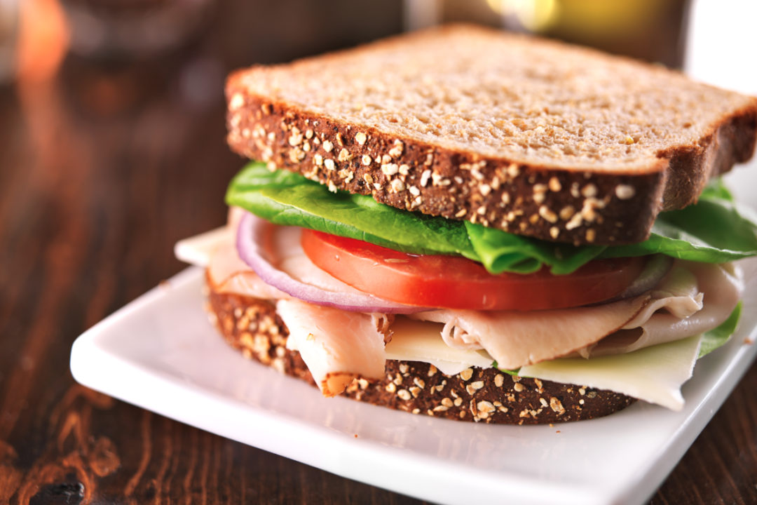 Turkey sandwich on whole wheat bread with Swiss cheese