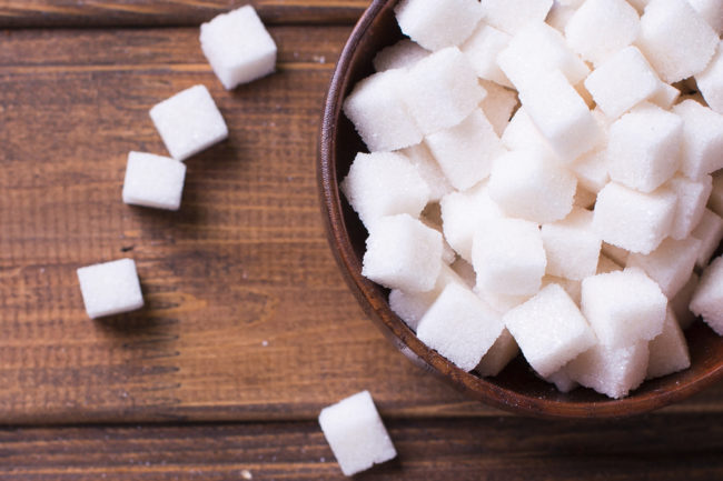 Sugar cubes in wooden bowl
