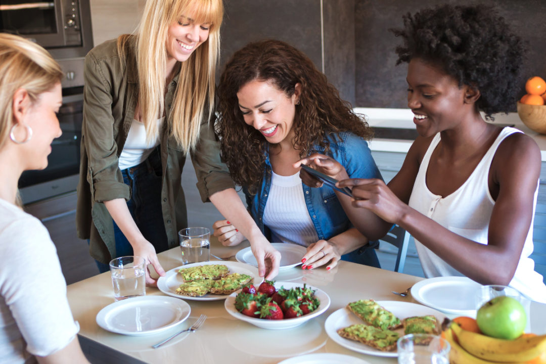 Four friends eating healthy food
