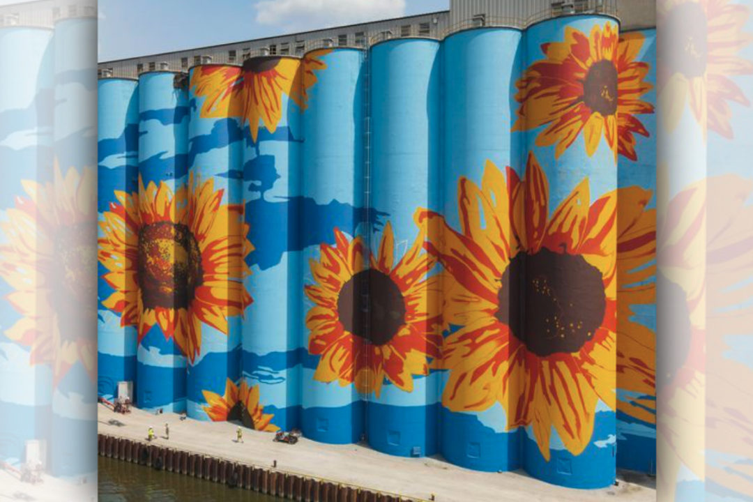 ADM Glass City River Wall painted with sunflowers