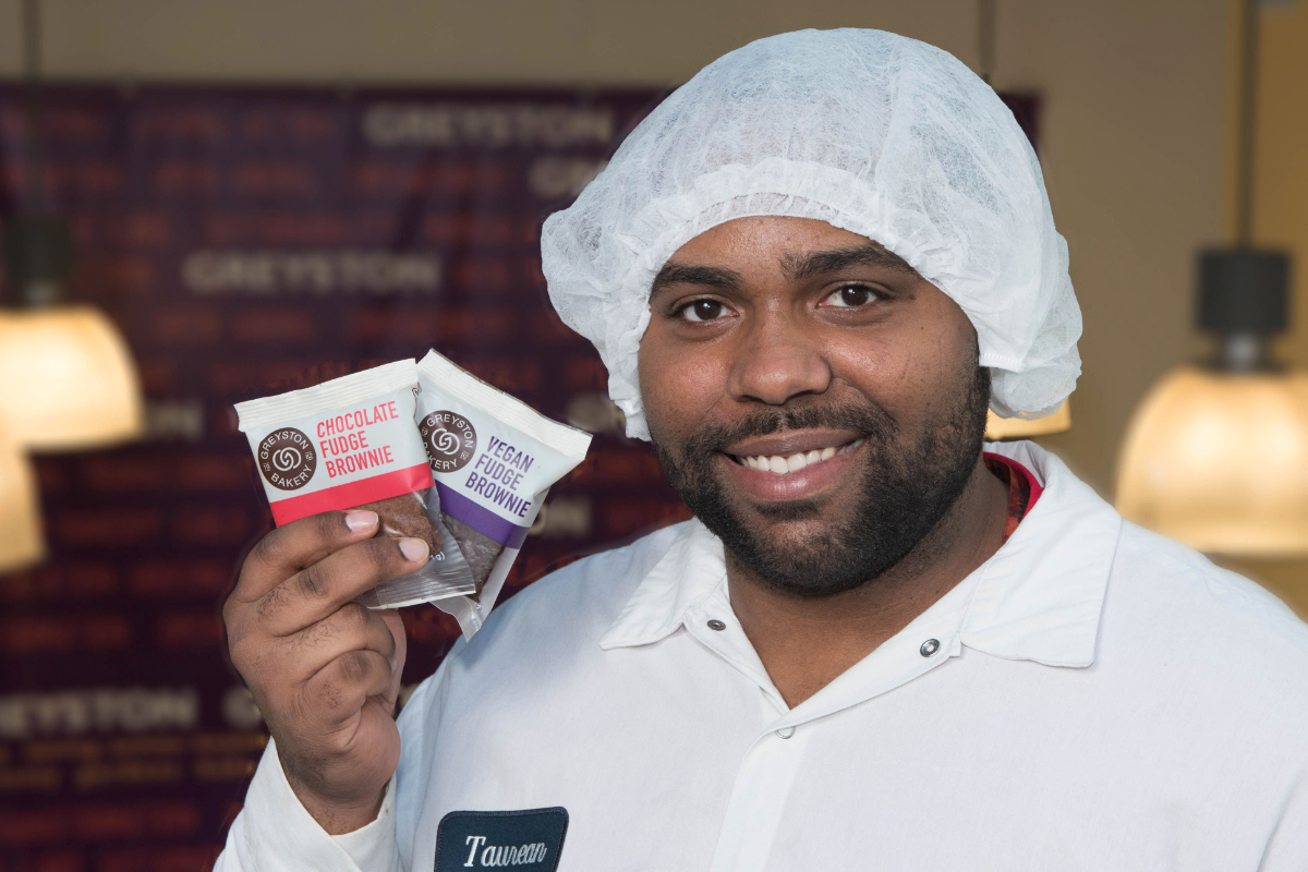 Greyston Bakery worker holding brownies