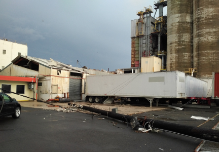 Photo shows a downed power pole and warehouse damage on the Molinos de Puerto Rico property