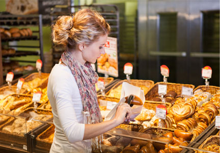 Millennial shopping for fresh bread at bakery