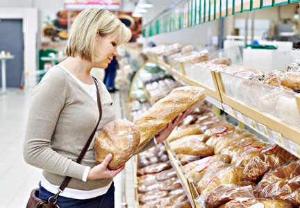Shopping for bread in grocery store