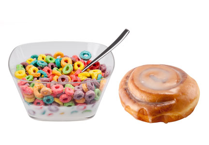 Bowl of cereal and a cinnamon roll