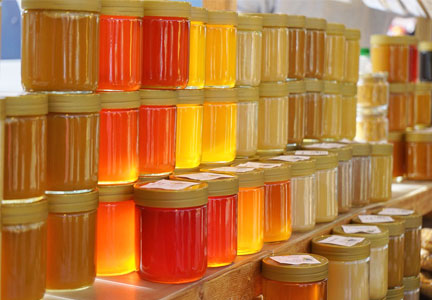 Jars of colorful honey