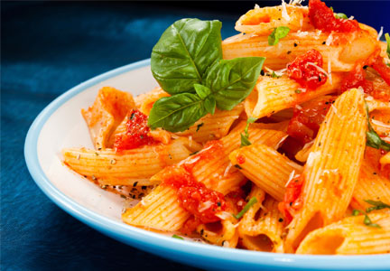 Plate of penne pasta with marinara sauce
