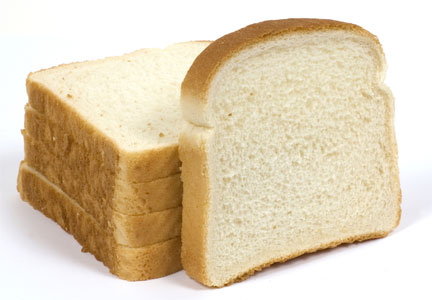 Slices of white bread made with refined grains