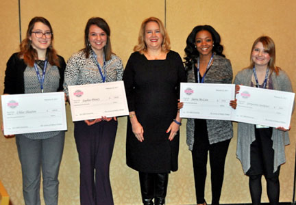 Lee Sanders (center) announced four SBW scholarship winners — (from left) Chloe Shearon, Sophia Pitney, Sierra McCain and Georgeanna Stockemer — during the ATBI Early Bird Breakfast at ASB.
