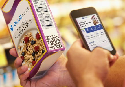 Consumer scanning QR code on food package