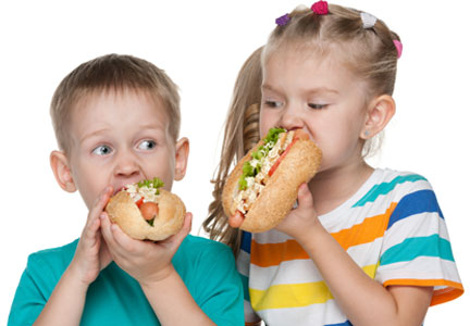 Children eating whole grain hot dog buns